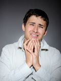Expressions.young man feeling fear and crying Royalty Free Stock Photo