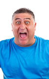 Expressions - Young man screaming of joy and luck. Studio shot Royalty Free Stock Images