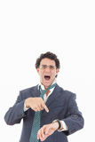 Expressive angry businessman with galsses late for work royalty free stock photography