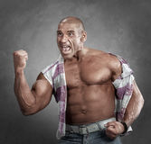 Expressive angry muscular man showing gesture his fist. Portrait of angry muscular man showing gesture his fist Stock Photography