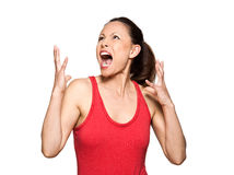 Expressive angry woman looking up and screaming Royalty Free Stock Photos