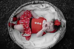 Expressive baby girl in wicker basket portrait Royalty Free Stock Photos