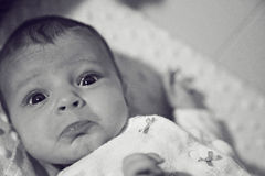 Expressive baby poking out lips Royalty Free Stock Photos
