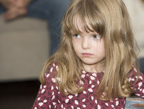 Expressive & Beautiful Little Girl with Blond Hair & Blue Eyes Stock Photo