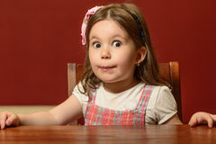 Expressive beautiful little girl playing Stock Photography