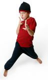 Expressive boy. In casual clothes standing barefoot on a white background stock photo
