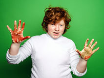 Expressive boy showing colorful hands after drawing Royalty Free Stock Photography