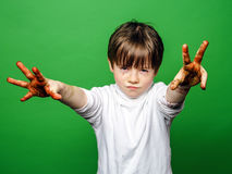 Expressive boy showing colorful hands after drawing Stock Photo
