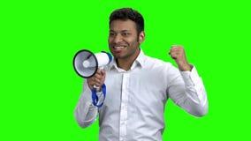 Expressive businessman talking in megaphone. stock footage