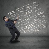 Expressive businessperson having tax problems Stock Images