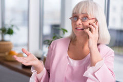 Expressive businesswoman calling someone Royalty Free Stock Photography