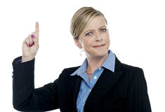 Expressive businesswoman with pointing finger Stock Images