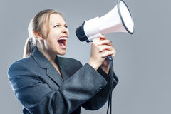 Expressive Caucasian Blond Female Screaming Using Big White Mega Royalty Free Stock Images