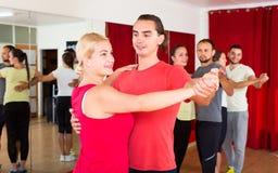 Expressive couple learning tango Stock Photos