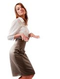 Expressive dance of young lady. Studio portrait of young lady in office-style clothes dancing expressively Stock Photo