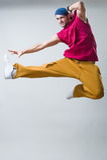 Expressive dancer. Studio shot over light background stock photography