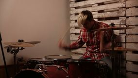 Expressive drummer playing on drums in club stock video footage
