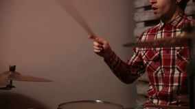 Expressive drummer playing drums with drum stick stock video footage