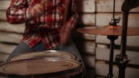 Expressive drummer playing at drums with drumstick stock video