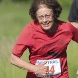 Expressive elderly runner. Stock Photos