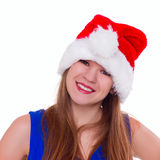 Expressive emotional girl in a Christmas hat on white background Royalty Free Stock Image