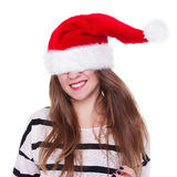 Expressive emotional girl in a Christmas hat on white background Stock Photography