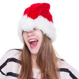 Expressive emotional girl in a Christmas hat on white background Stock Image