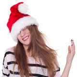 Expressive emotional girl in a Christmas hat on white background Royalty Free Stock Images