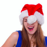 Expressive emotional girl in a Christmas hat on white background Royalty Free Stock Photos