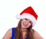 Expressive emotional girl in a Christmas hat on white background Stock Images