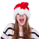 Expressive emotional girl in a Christmas hat on white background Royalty Free Stock Photo