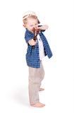Expressive emotional little boy with slingshot Stock Images