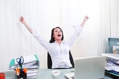 Expressive employee. Shouting happily in office stock images