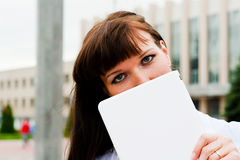Expressive eyes female. Female hid behind the netbook Royalty Free Stock Photography
