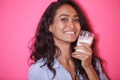 Expressive face of asian woman with a glass of milk Stock Photo