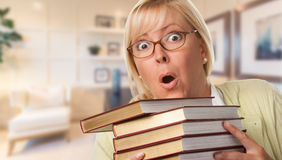 Expressive Female Student or Businesswoman with Stack of Books Stock Images