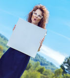 Expressive funny woman holding white board Royalty Free Stock Photography