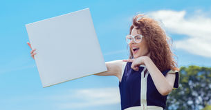 Expressive funny woman holding white board Royalty Free Stock Photos