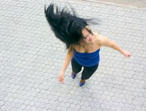 Expressive girl in motion. Crazy expressive young girl in motion Royalty Free Stock Image