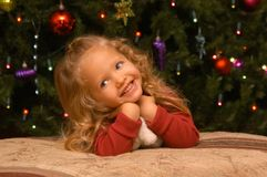 Expressive Girl - Smiling. A two-and-a-half year old girl tests out her own poses and expressions in front of the camera Royalty Free Stock Photos