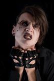 Expressive Gothic Boy With Artistic Make-up Royalty Free Stock Photography