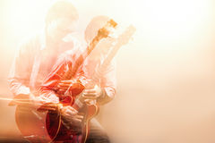 Expressive Guitarist Player With Acoustic Guitar. Shot with Comb Stock Image