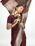 Expressive indian woman with pink roses Stock Photo