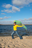 Expressive joyful  woman happily goes to meet the wind,  having Stock Images