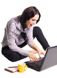 Expressive laughing girl with laptop Stock Images