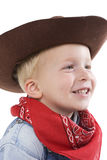 Expressive little boy. Happy young boy with a cowboy hat royalty free stock photography