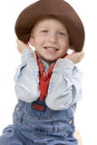 Expressive little boy. Happy young boy with a cowboy hat stock photo