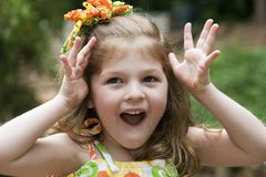 Expressive little girl. Cute girl playing stock images