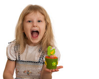 Expressive little girl with Easter toy. An expressive little girl is holding an Easter toy; isolated on the white background royalty free stock photos