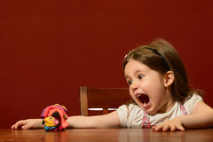 Expressive little girl playing Royalty Free Stock Images